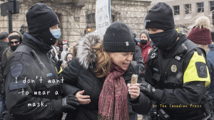Police detain a woman during a demonstration in Montreal, Sunday, December 20, 2020, where people protested measures implemented by the Quebec government to help stop the spread of COVID-19. The COVID-19 pandemic continues in Canada and around the world. PHOTO BY GRAHAM HUGHES /The Canadian Press